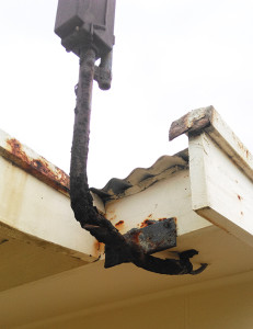 DANGER: This electrical feed bracket into this house is so rusty it could easy break off and pull down live electrical wires into the house. How is yours?
