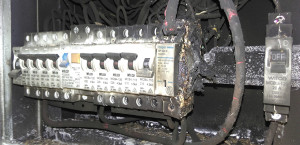 LEAKY BOX: A leaking fuse box was the cause of this electrical fire that threatened property and life. Is yours waterproof?